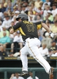 Feb 26, 2014; Bradenton, FL, USA; Pittsburgh Pirates first baseman Gaby Sanchez (17) singles during the third inning against the New York Yankees at McKechnie Field. Mandatory Credit: Kim Klement-USA TODAY Sports