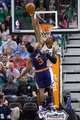 Feb 26, 2014; Salt Lake City, UT, USA; Utah Jazz center Derrick Favors (15) blocks the shot of Phoenix Suns point guard Ish Smith (3) during the second half at EnergySolutions Arena. The Jazz won 109-86. Mandatory Credit: Russ Isabella-USA TODAY Sports