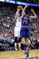 Feb 26, 2014; Salt Lake City, UT, USA; Utah Jazz shooting guard Gordon Hayward (20) shoots over Phoenix Suns shooting guard Gerald Green (14) during the second half at EnergySolutions Arena. The Jazz won 109-86. Mandatory Credit: Russ Isabella-USA TODAY Sports