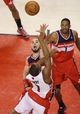 Feb 27, 2014; Toronto, Ontario, CAN; Toronto Raptors point guard Kyle Lowry (7) attempts a game-winning shot on the last play of the fourth quarter but cannot convert against Washington Wizards center Marcin Gortat (4) at Air Canada Centre. Mandatory Credit: Tom Szczerbowski-USA TODAY Sports