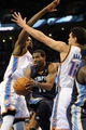 Feb 28, 2014; Oklahoma City, OK, USA; Memphis Grizzlies point guard Mike Conley (11) drives the lane against Oklahoma City Thunder power forward Serge Ibaka (9) and t12/ during the first quarter at Chesapeake Energy Arena. Mandatory Credit: Mark D. Smith-USA TODAY Sports
