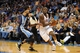 Feb 28, 2014; Oklahoma City, OK, USA; Oklahoma City Thunder point guard Reggie Jackson (15) drives the ball against Memphis Grizzlies point guard Mike Conley (11) during the third quarter at Chesapeake Energy Arena. Mandatory Credit: Mark D. Smith-USA TODAY Sports