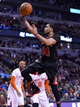 Mar 2, 2014; Chicago, IL, USA; Chicago Bulls point guard D.J. Augustin (14) shoots the ball against the New York Knicks during the second half at the United Center. Chicago defeats New York 109-90. Mandatory Credit: Mike DiNovo-USA TODAY Sports