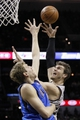 Mar 2, 2014; San Antonio, TX, USA; San Antonio Spurs forward Tiago Splitter (behind) takes a shot over Dallas Mavericks forward Dirk Nowitzki (front) during the first half at AT&T Center. Mandatory Credit: Soobum Im-USA TODAY Sports