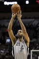Mar 2, 2014; San Antonio, TX, USA; San Antonio Spurs forward Tim Duncan (21) shoots the ball during the first half against the Dallas Mavericks at AT&T Center. Mandatory Credit: Soobum Im-USA TODAY Sports
