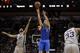 Mar 2, 2014; San Antonio, TX, USA; Dallas Mavericks guard Jose Calderon (8) shoots the ball against San Antonio Spurs guard Tony Parker (9) during the second half at AT&T Center. Mandatory Credit: Soobum Im-USA TODAY Sports