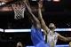Mar 2, 2014; San Antonio, TX, USA; Dallas Mavericks center Samuel Dalembert (1) dunks past San Antonio Spurs forward Tim Duncan (21) during the second half at AT&T Center. Mandatory Credit: Soobum Im-USA TODAY Sports