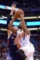Mar 2, 2014; Phoenix, AZ, USA; Phoenix Suns power forward Markieff Morris (11) goes up for a layup against the Atlanta Hawks during the first half at US Airways Center. Mandatory Credit: Joe Camporeale-USA TODAY Sports