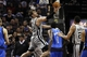 Mar 2, 2014; San Antonio, TX, USA; San Antonio Spurs forward Tiago Splitter (22) shoots the ball as Dallas Mavericks center Samuel Dalembert (1) looks on during the second half at AT&T Center. The Spurs won 112-106. Mandatory Credit: Soobum Im-USA TODAY Sports