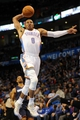 Mar 2, 2014; Oklahoma City, OK, USA; Oklahoma City Thunder point guard Russell Westbrook (0) dunks the ball against the Charlotte Bobcats during the fourth quarter at Chesapeake Energy Arena. Mandatory Credit: Mark D. Smith-USA TODAY Sports