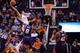 Mar 2, 2014; Phoenix, AZ, USA; Phoenix Suns shooting guard Gerald Green (14) dunks over Atlanta Hawks point guard Shelvin Mack (8) in the second half at US Airways Center. The Phoenix Suns won the game 129-120. Mandatory Credit: Joe Camporeale-USA TODAY Sports