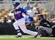 March 4, 2014; Phoenix, AZ, USA; Los Angeles Dodgers third baseman Juan Uribe (5) hits a single in the second inning against the Seattle Mariners at Camelback Ranch. Mandatory Credit: Gary A. Vasquez-USA TODAY Sports