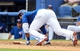 Mar 5, 2014; Dunedin, FL, USA; Toronto Blue Jays outfielder Jose Bautista (19) gets knocked down by a pitch during the spring training exhibition game against the Pittsburg Pirates at Florida Auto Exchange Park. Mandatory Credit: Jonathan Dyer-USA TODAY Sports