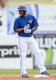 Mar 5, 2014; Dunedin, FL, USA; Toronto Blue Jays infielder Edwin Encarnacion (10) smiles after hitting a double during the spring training exhibition game against the Pittsburg Pirates at Florida Auto Exchange Park. Mandatory Credit: Jonathan Dyer-USA TODAY Sports