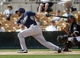 Mar 5, 2014; Phoenix, AZ, USA; San Diego Padres left fielder Xavier Nady (21) hits an RBI single during the first inning against the Chicago White Sox at Camelback Ranch. Mandatory Credit: Rick Scuteri-USA TODAY Sports