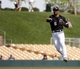 Mar 5, 2014; Phoenix, AZ, USA; Chicago White Sox shortstop Marcus Semien (5) makes the off balance throw against the San Diego Padres during the fourth inning at Camelback Ranch. Mandatory Credit: Rick Scuteri-USA TODAY Sports