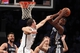 Mar 5, 2014; Brooklyn, NY, USA; Memphis Grizzlies shooting guard Tony Allen (9) grabs a rebound against Brooklyn Nets power forward Mirza Teletovic (33) during the second quarter of a game at Barclays Center. Mandatory Credit: Brad Penner-USA TODAY Sports
