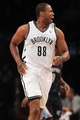 Mar 5, 2014; Brooklyn, NY, USA; Brooklyn Nets center Jason Collins (98) reacts during the second quarter of a game against the Memphis Grizzlies at Barclays Center. Mandatory Credit: Brad Penner-USA TODAY Sports