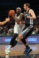 Mar 5, 2014; Brooklyn, NY, USA; Brooklyn Nets center Andray Blatche (0) drives past Memphis Grizzlies center Kosta Koufos (41) during the third quarter of a game at Barclays Center. The Nets defeated the Grizzlies 103-94. Mandatory Credit: Brad Penner-USA TODAY Sports