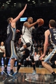 Mar 5, 2014; Brooklyn, NY, USA; Brooklyn Nets shooting guard Marcus Thornton (10) drives to the basket past Memphis Grizzlies center Kosta Koufos (41) and Memphis Grizzlies power forward Jon Leuer (30) during the fourth quarter of a game at Barclays Center. The Nets defeated the Grizzlies 103-94. Mandatory Credit: Brad Penner-USA TODAY Sports