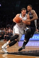 Mar 5, 2014; Brooklyn, NY, USA; Brooklyn Nets power forward Mirza Teletovic (33) drives past Memphis Grizzlies power forward James Johnson (3) during the fourth quarter of a game at Barclays Center. The Nets defeated the Grizzlies 103-94. Mandatory Credit: Brad Penner-USA TODAY Sports