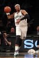 Mar 5, 2014; Brooklyn, NY, USA; Brooklyn Nets small forward Paul Pierce (34) controls the ball after grabbing a rebound against the Memphis Grizzlies during the fourth quarter of a game at Barclays Center. The Nets defeated the Grizzlies 103-94. Mandatory Credit: Brad Penner-USA TODAY Sports