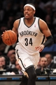 Mar 5, 2014; Brooklyn, NY, USA; Brooklyn Nets small forward Paul Pierce (34) controls the ball against the Memphis Grizzlies during the fourth quarter of a game at Barclays Center. The Nets defeated the Grizzlies 103-94. Mandatory Credit: Brad Penner-USA TODAY Sports