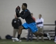 Mar 7, 2014; Columbus, OH, USA; Ohio State Buckeyes running back Carlos Hyde works out in front of NFL scouts on pro day  at The Woody Hayes Athletic Center. Mandatory Credit: Greg Bartram-USA TODAY Sports