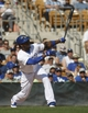 Mar 7, 2014; Phoenix, AZ, USA; Los Angeles Dodgers shortstop Hanley Ramirez (13) hits against the Texas Rangers in the fifth inning at Camelback Ranch. Mandatory Credit: Rick Scuteri-USA TODAY Sports