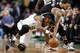 Mar 7, 2014; Boston, MA, USA; Boston Celtics point guard Rajon Rondo (9) battles Brooklyn Nets point guard Deron Williams (8) for a loose ball during the second quarter at TD Garden. Mandatory Credit: Winslow Townson-USA TODAY Sports