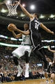 Mar 7, 2014; Boston, MA, USA; Boston Celtics small forward Chris Johnson (12) tries to get to the basket past Brooklyn Nets point guard Shaun Livingston (14) during the second half of Boston's 91-84 win at TD Garden. Mandatory Credit: Winslow Townson-USA TODAY Sports