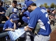 Mar 8, 2014; Phoenix, AZ, USA; Kansas City Royals first baseman Eric Hosmer (35) signs autographs before a game against the Milwaukee Brewers at Maryvale Baseball Park. Mandatory Credit: Rick Scuteri-USA TODAY Sports