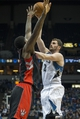 Mar 9, 2014; Minneapolis, MN, USA; Minnesota Timberwolves power forward Kevin Love (42) goes up for a shot over Toronto Raptors power forward Amir Johnson (15) in the second half at Target Center. The Raptors won 111-104. Mandatory Credit: Jesse Johnson-USA TODAY Sports