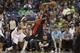 Mar 9, 2014; Minneapolis, MN, USA; Toronto Raptors shooting guard DeMar DeRozan (10) passes the ball past Minnesota Timberwolves small forward Corey Brewer (13) in the second half at Target Center. The Raptors won 111-104. Mandatory Credit: Jesse Johnson-USA TODAY Sports