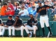 Mar 10, 2014; Scottsdale, AZ, USA; San Francisco Giants former outfielder Barry Bonds (second from left) watches during the game against the Chicago Cubs at Scottsdale Stadium. Mandatory Credit: Mark J. Rebilas-USA TODAY Sports