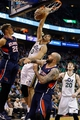 Mar 10, 2014; Salt Lake City, UT, USA; Utah Jazz center Enes Kanter (0) dunks while being guarded by Atlanta Hawks center Pero Antic (6) during the third quarter at EnergySolutions Arena. The Atlanta Hawks won the game 112-110. Mandatory Credit: Chris Nicoll-USA TODAY Sports