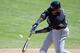 Mar 11, 2014; Tempe, AZ, USA; Seattle Mariners second baseman Robinson Cano (22) at bat against the Los Angeles Angels at Tempe Diablo Stadium. Mandatory Credit: Joe Camporeale-USA TODAY Sports