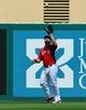 Mar 11, 2014; Jupiter, FL, USA; St. Louis Cardinals left fielder Matt Holliday (7) makes a catch against the New York Mets at Roger Dean Stadium. The Mets defeated the Cardinals 9-8. Mandatory Credit: Scott Rovak-USA TODAY Sports