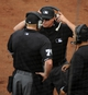 Mar 11, 2014; Surprise, AZ, USA; Home plate umpire Tom Woodring (front) and base umpire Cory Blaser review a play during the Los Angeles Dodgers game against the Kansas City Royals at Surprise Stadium. Mandatory Credit: Christopher Hanewinckel-USA TODAY Sports