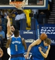 Mar 11, 2014; Oakland, CA, USA; The ball hits Dallas Mavericks forward Dirk Nowitzki (41) after a dunk by Golden State Warriors center Andrew Bogut (12) during the second quarter at Oracle Arena. Mandatory Credit: Kelley L Cox-USA TODAY Sports