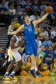 Mar 11, 2014; Oakland, CA, USA; Dallas Mavericks forward Dirk Nowitzki (41) controls a pass against Golden State Warriors forward Harrison Barnes (40) during the fourth quarter at Oracle Arena. The Golden State Warriors defeated the Dallas Mavericks 108-85. Mandatory Credit: Kelley L Cox-USA TODAY Sports
