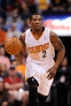Mar 12, 2014; Phoenix, AZ, USA; Phoenix Suns guard Eric Bledsoe (2) dribbles the ball up the court against the Cleveland Cavaliers in the second half at US Airways Center. The Cavaliers won 110-101.  Mandatory Credit: Jennifer Stewart-USA TODAY Sports