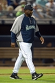 Mar 12, 2014; Peoria, AZ, USA; Seattle Mariners manager Lloyd McClendon walks to the mound against the Chicago Cubs at Peoria Sports Complex. Mandatory Credit: Joe Camporeale-USA TODAY Sports