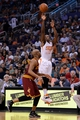 Mar 12, 2014; Phoenix, AZ, USA; Phoenix Suns guard Eric Bledsoe (2) shoots the ball against the Cleveland Cavaliers guard Jarrett Jack (1) in the second half at US Airways Center. The Cavaliers won 110-101.  Mandatory Credit: Jennifer Stewart-USA TODAY Sports
