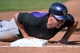 Mar 14, 2014; Scottsdale, AZ, USA; Colorado Rockies catcher Matt McBride (7) dives back into first base in the second inning against the San Francisco Giants at Scottsdale Stadium. Mandatory Credit: Joe Camporeale-USA TODAY Sports