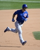 Mar 15, 2014; Surprise, AZ, USA; Chicago Cubs right fielder Brett Jackson (7) runs the bases after a three-run home run during the eighth inning against the Kansas City Royals at Surprise Stadium. Mandatory Credit: Christopher Hanewinckel-USA TODAY Sports