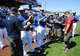Mar 15, 2014; Surprise, AZ, USA; Members of the Kansas City Royals talk with members of the Wounded Warrior Softball Team prior to the game against the Chicago Cubs at Surprise Stadium. Mandatory Credit: Christopher Hanewinckel-USA TODAY Sports