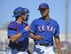 Mar 16, 2014; Surprise, AZ, USA; Texas Rangers starting pitcher Yu Darvish (11) talks with catcher J.P. Arencibia (7) after the third inning against the Chicago White Sox at Surprise Stadium. Mandatory Credit: Christopher Hanewinckel-USA TODAY Sports