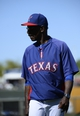 Mar 16, 2014; Surprise, AZ, USA; Texas Rangers manager Ron Washington walks to the dugout after a pitching change during the fifth inning against the Chicago White Sox at Surprise Stadium. Mandatory Credit: Christopher Hanewinckel-USA TODAY Sports