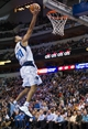 Feb 26, 2014; Dallas, TX, USA; Dallas Mavericks point guard Devin Harris (20) drives to the basket against the New Orleans Pelicans at the American Airlines Center. The Mavericks defeated the Pelicans 108-89. Mandatory Credit: Jerome Miron-USA TODAY Sports